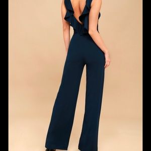 Lulu navy jumpsuit, ruffle back size Medium